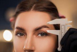 Woman having eyebrow treatment