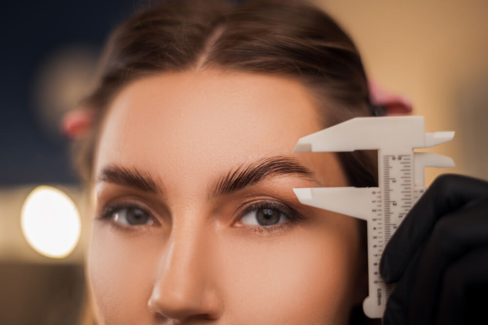 Woman having eyebrow treatment