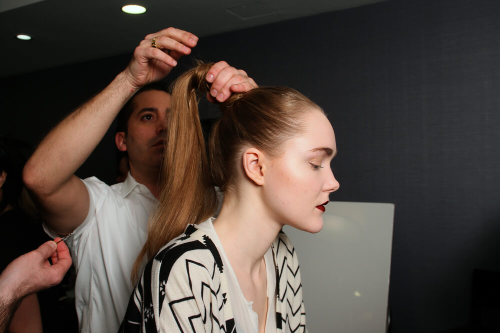 Hairstylist working on woman's hair