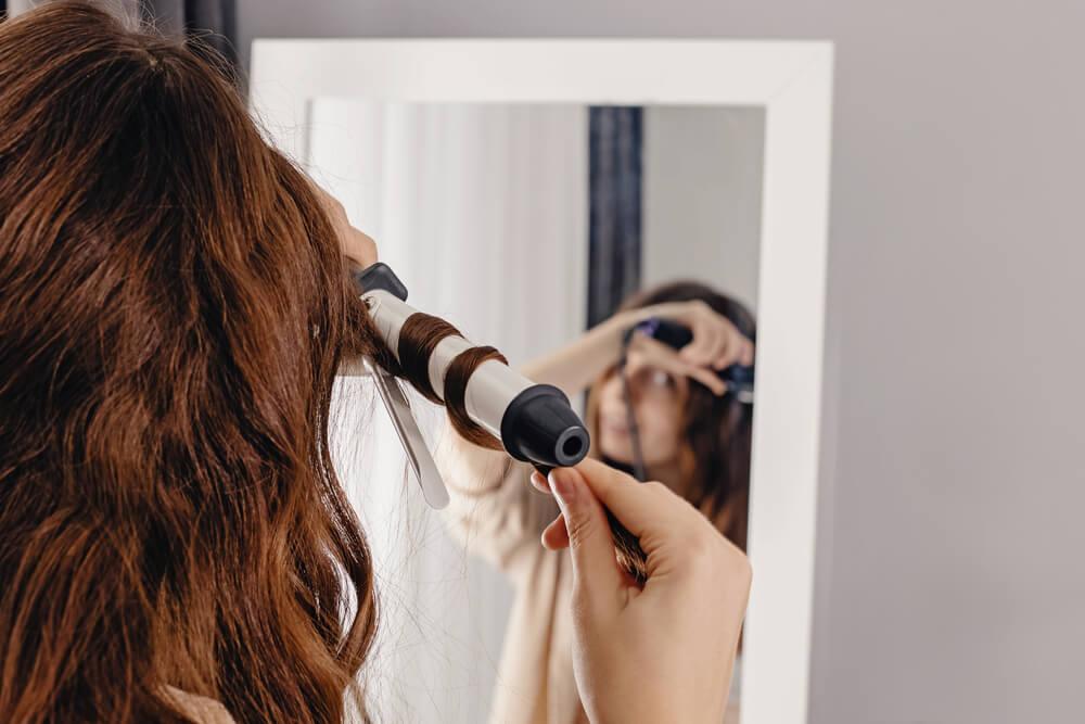 Woman curling hair