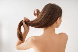 Woman applying the new evolution hair serum